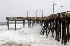 Waves hit the pier at Cape Hatteras National Seashore in Avon, North Carolina